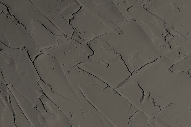 Strukturierter hintergrund der dunkelgrauen wandfarbe