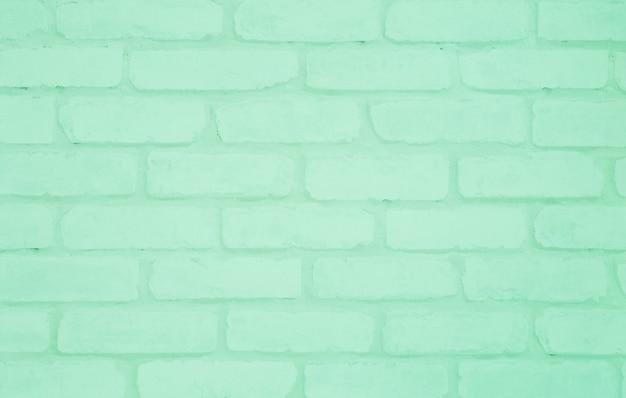 Strukturierter hintergrund der grünen backsteintapetenoberflächenwand der nahaufnahme