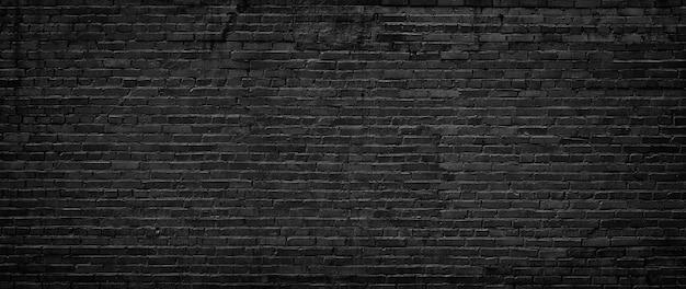 Strukturierter hintergrund der schwarzen backsteinmauer