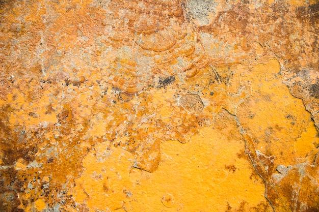 Strukturierter hintergrund des gelben steins