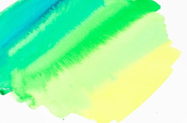 Strukturierter hintergrund des gelben und grünen bürstenanschlags