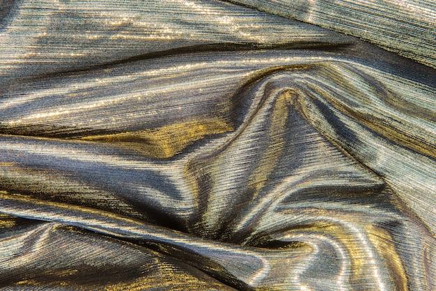 Strukturierter hintergrund des glänzenden silbernen gewebes