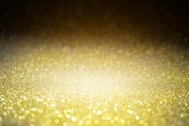 Strukturierter hintergrund glitter funkeln goldglitter glitzernden luxus und wert.