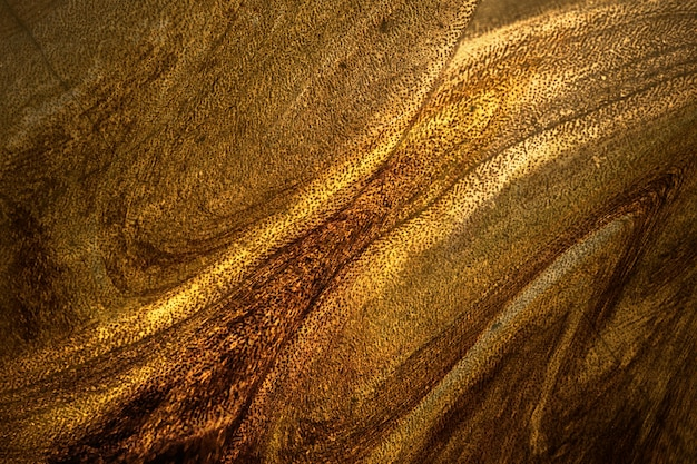 Strukturierter hintergrund mit dunkler goldfarbe