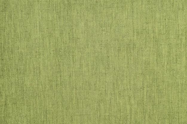 Strukturierter hintergrund oder tapete aus dem rauen stoff von green lime color