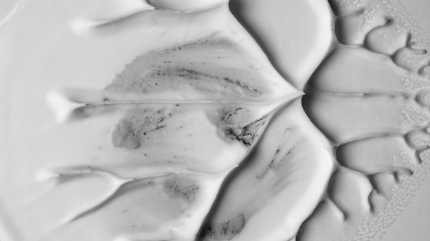 Strukturierter künstlerischer hintergrund des glatten weißen schaums