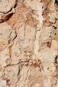 Strukturierter stein, sandstein, kalksteinoberfläche. bild schließen. stein, natürliche abstrakte textur für hintergründe. nahansicht. tapete, architektur.