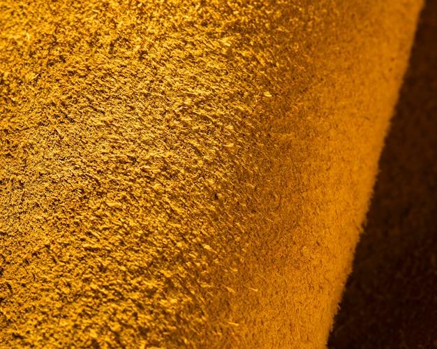 Strukturiertes gelbes leder aus extremer nahaufnahme