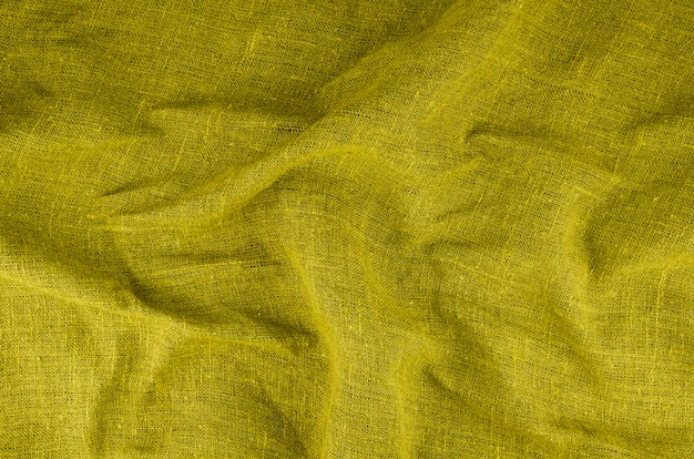 Strukturiertes material aus gelbem stoff