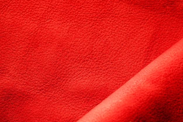 Strukturiertes rotes leder aus extremer nahaufnahme