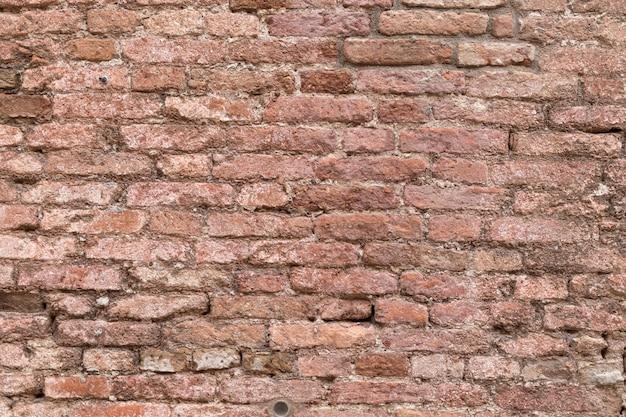 Stuck auf der backsteinmauer in italien. wand textur hintergrund.