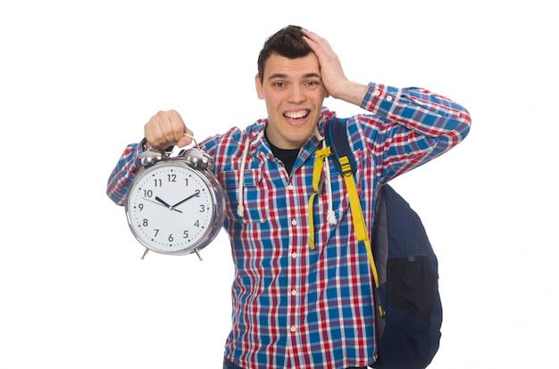 Student, der wecker lokalisiert auf weiß hält