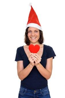 Studioaufnahme der schönen frau mit den kurzen haaren bereit für weihnachten lokalisiert gegen weißen hintergrund