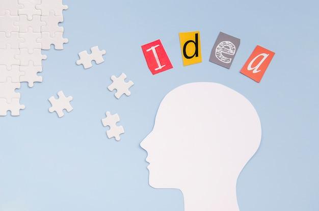 Stücke des puzzlespiels mit ideenwortkonzept
