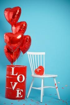 Stuhl mit einer schachtel in form eines herzens und roten luftballons