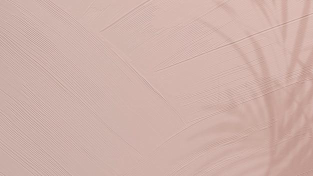 Stumpfer rosa farbtexturhintergrund mit blattschatten