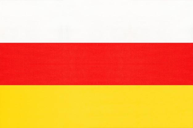 Südossetien national stoff flagge textil hintergrund, symbol der welt asiatischen land,