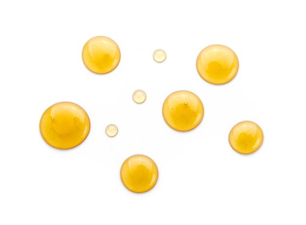 Süßer honig getrennt auf weißem hintergrund.