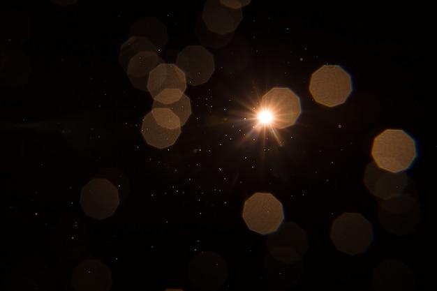 Sun flare auf schwarzem objektdesign.