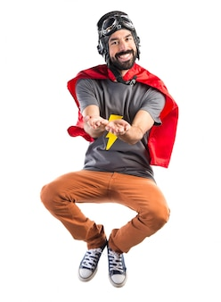 Superheld hält etwas