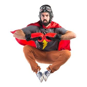 Superheld mit boxhandschuhen