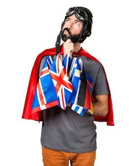Superheld mit vielen fahnen denken