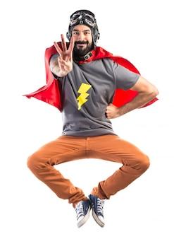 Superheld zählt drei