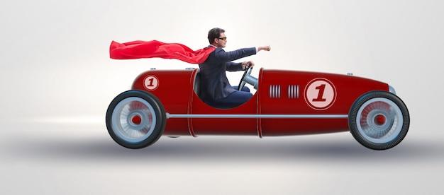Superheldgeschäftsmann, der weinlese roadster fährt