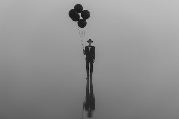 Surreales porträt eines mannes in einem anzug mit einem hut mit luftballons in der hand auf dem wasser