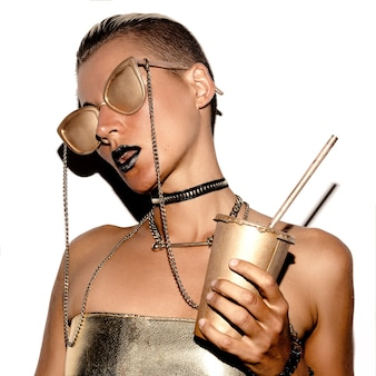 Swag girl luxus-stil. gold-party. gold-accessoires vip