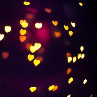 Swirl von glänzenden Herzen
