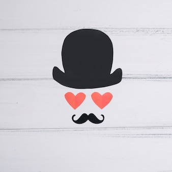 Symbol des mannes der papierherzen und des dekorativen schnurrbartes