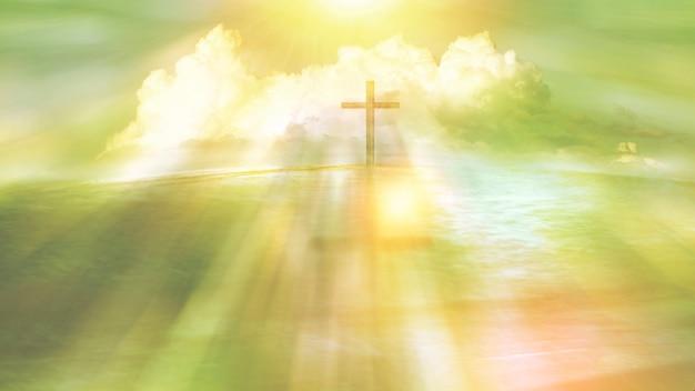 Symbol des religiösen kreuzes auf einem strand mit sonnenstrahl und -wolke