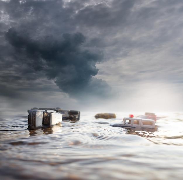 Szene von zerschmetterten autos (miniatur, spielzeugmodell) in der flut von den naturkatastrophen selektiver fokus.