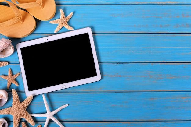Tablet-computer sommer strand hintergrund