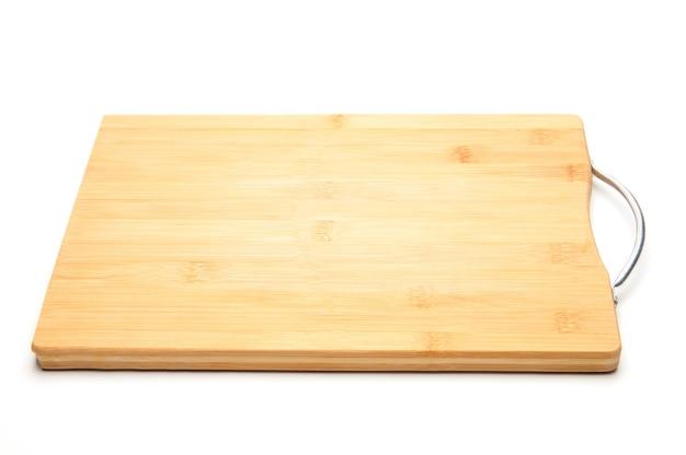 Tafel zum schneiden von gemüse, früchten, fleisch auf einem isolierten weißen hintergrund