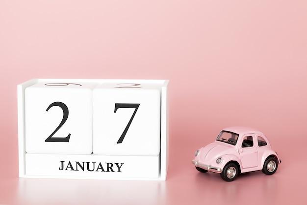Tag 27 des januar-monats, kalender auf einem rosa hintergrund mit retro- auto.