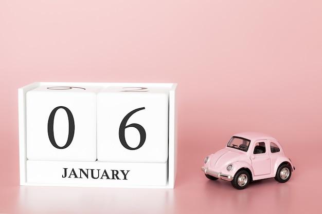 Tag 6 des januar-monats, kalender auf einem rosa hintergrund mit retro- auto.
