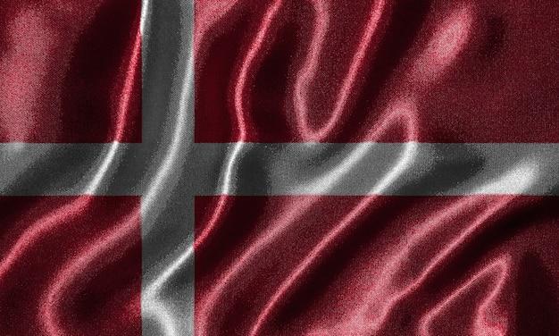 Tapete durch dänemark-flagge und wellenartig bewegende flagge durch gewebe.