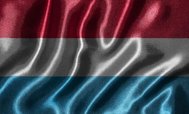 Tapete durch luxemburg-flagge und wellenartig bewegende flagge durch gewebe.