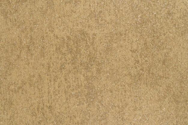 Tapisserie-oberflächenhintergrund mit leuchtender goldener marmorierung