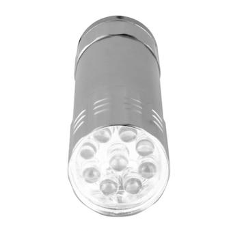 Taschenlampe klein lokalisiert auf weißer wand