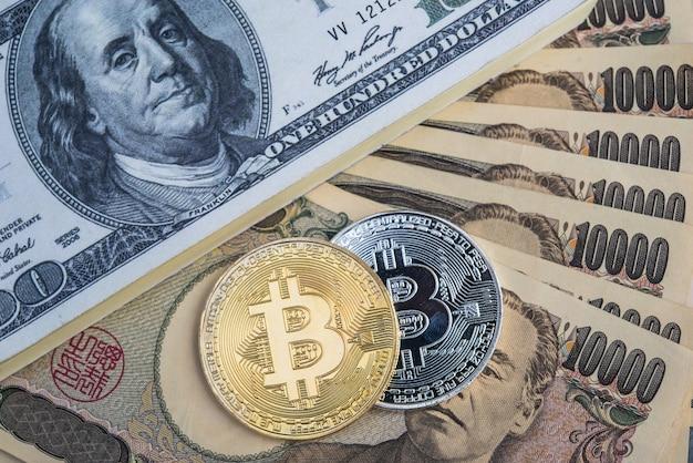 Tauschen sie bitcoin gegen einen dollar und japanische yen-banknoten.