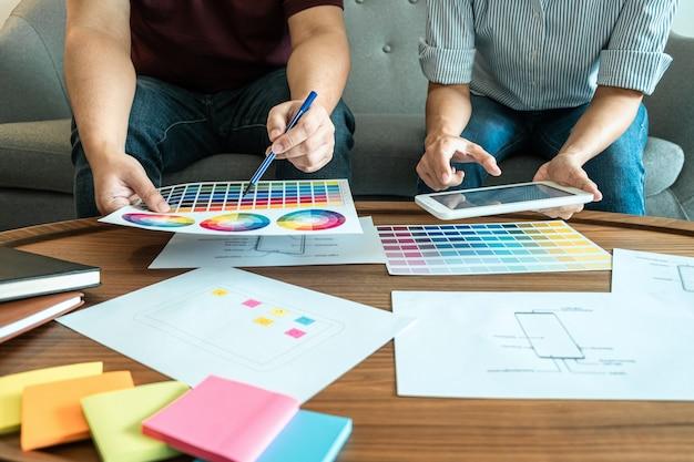 Team von kreativen designern planung, zeichnung
