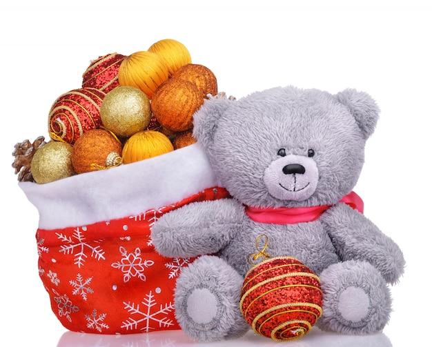 Teddybär mit santa tasche voller spielzeug