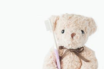 Teddybär hält Zahnbürste