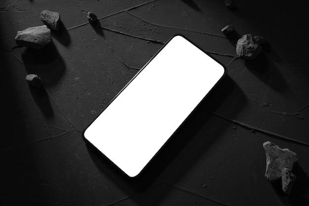 Telefon draufsicht mit weißem bildschirm auf beton, steintisch. hartes licht und schatten