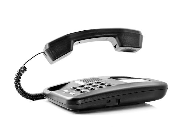 Telefon isoliert auf weißem hintergrund mit schwebendem hörer