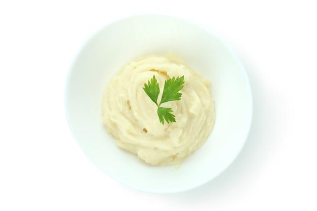 Teller mit kartoffelpüree isoliert auf weiss