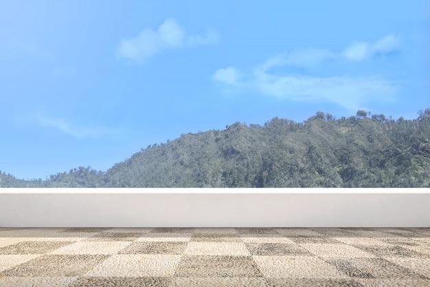 Terrasse mit grüner hügelansicht und blauem himmel